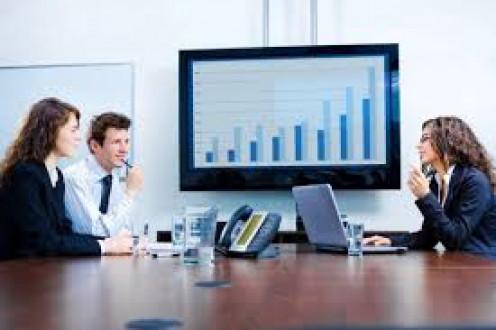 Charts seen on big-screen monitors help big corporate meetings to be organized