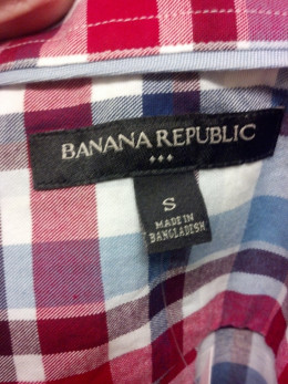 Banana Republic Outlet tag with 3 diamonds.  You'll find similar markings on Gap, J. Crew, and other brands.