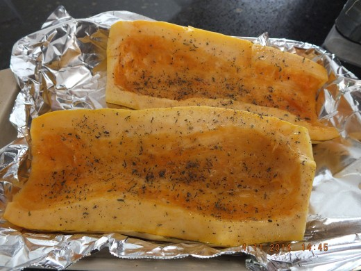 I used a little less than a tablespoon of olive oil and used a silcone pastry brush to coat both halves of the squash. I then sprinkled it with about 2 teaspoons of dried thyme. Next, off to the oven!