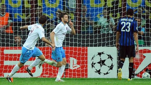 Ondrej Celustka (center) and Halil Altintop (left) celebrate after Celustka scored against Inter Milan as Trabzonspor won 1-0 in San Siro on Sept. 14, 2011.