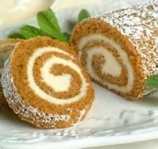 Pumpkin Cake Roll Sprinkled with Confectioners Sugar