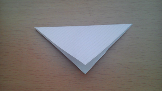 Fold the top corner down to make a triangle. Make sure your upper and lower edges are aligned.