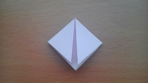 Fold left and right corners down to make a diamond shape.