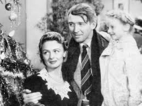 "Donna Reed, left, co-stars with Jimmy Stewart and Karolyn Grimes ""Zu Zu"" .in ""It's a Wonderful Life."""