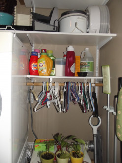These shelves hold all of my laundry supplies and important as it is, it also makes the room look cluttered.