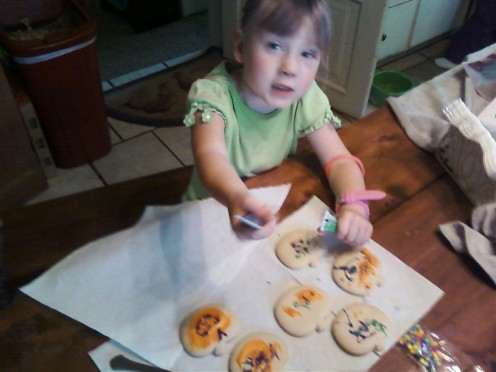 3) Start putting colored icing upon your cookies.