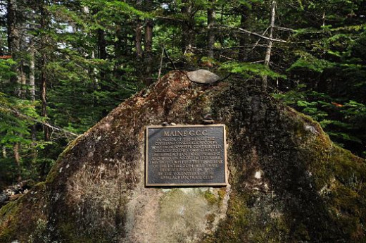 A marker set along the trail near Spaulding and Sugarloaf Mountains that commemorates the completion of the final portion of the Appalachain Trail by workers from the Civilian Conservation Corps. The marker was placed at that spot in 1987.