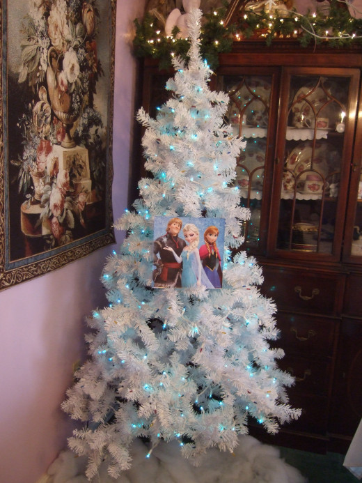 Elsa, Anna & Kristoff on the white Christmas tree by using an ornament hook.