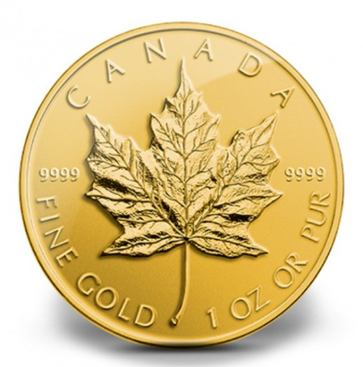 2014 Gold Maple Leaf -  this coins is 1 ounce of 99.999 percent gold.  The Queen's effigy is on the opposite side.