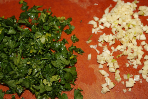 Chopped parsley and garlic for the herb butter stuffing.