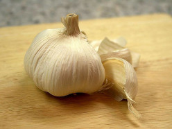 A big garlic clove!  Garlic pepper, salt, or just a tiny bit of chopped garlic can be great on a grilled cheese sandwich!