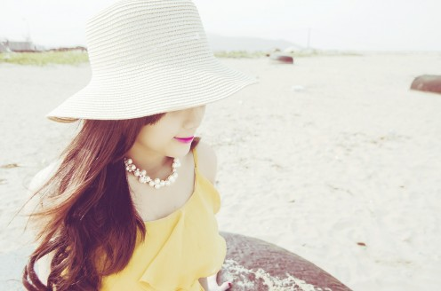 Woman in sun: Aspirin helps to treat the appearance of sun spots and age spots.