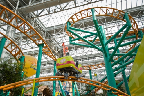 Nickelodeon Universe is located at the Mall of America and it has a roller coaster inside among other rides for adults and children.