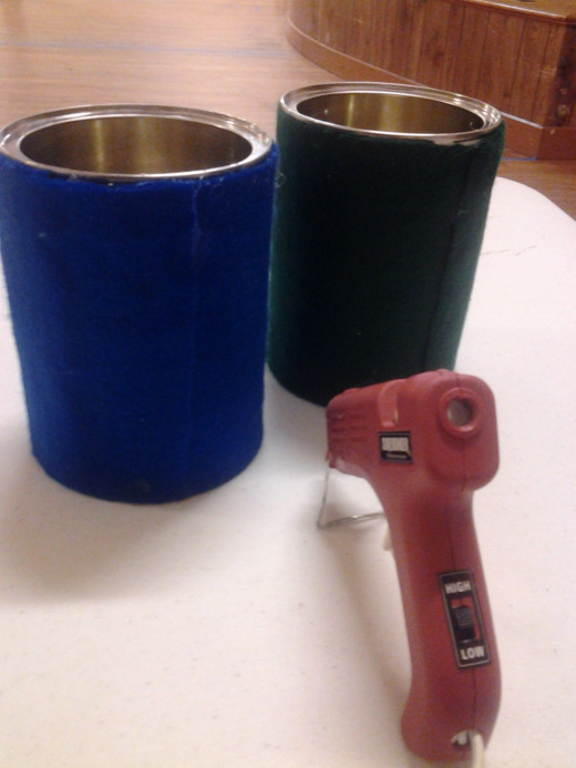 Felted coffee cans and the glue gun used to do it