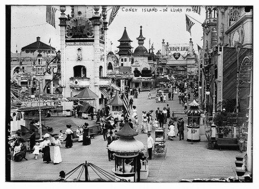 Inside one of the Gates to Luna Park ~1910 (notice the wording on the sign is backwards, indicating no sign backing).