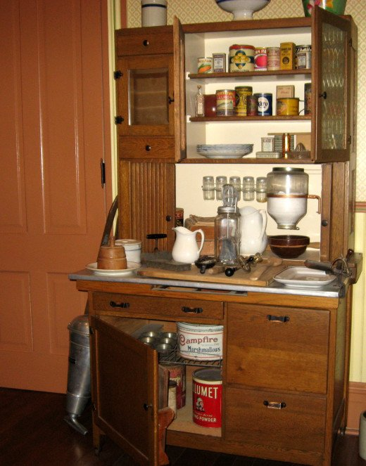 Maybe you don't have room for grandma's Hoosier cabinet but surely you can squeeze a bread box into your rustic kitchen decor. The box will earn its keep by storing all that clutter from the counter.