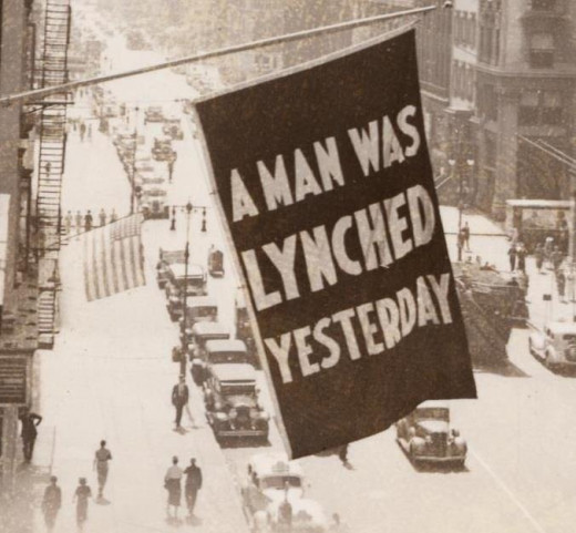 The Fallacy of Racism and its effect upon African American Homes; The flag hung in Harlem -- from the offices of the NAACP during the 1930s -- whenever news of a lynching was received.
