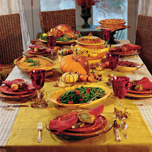 A Thanksgiving Dinner banquet arrangement for a large gathering.
