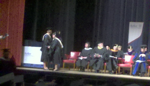 Walking across the graduation stage at Vets Memorial, February 2012.