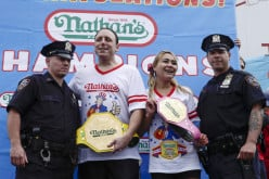 Joey Chestnut and Miki Sudo accept First and Second places in Nathan's Fourht of July Hot-Dog Eating Contest
