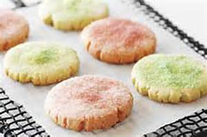 pastel jello cookies that have been flattened with jello on a glass