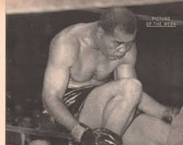 "Joe Louis, ""The Brown Bomber,"" sits dazed about a hard punch by Rocky Marciano"