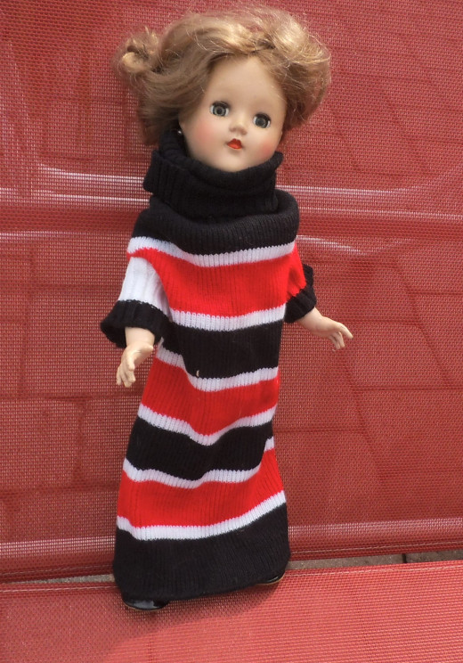 My sister sent this knit dress for my doll. Since I have the P-90 which is the shortest Toni doll, it seems too big on her. I'm thinking it would fit the P-93 Toni better. It's probably is a dog sweater. Look for cute outfits in the pet section.