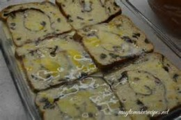 Soaking your raisin bread with the scrambled egg mixture.
