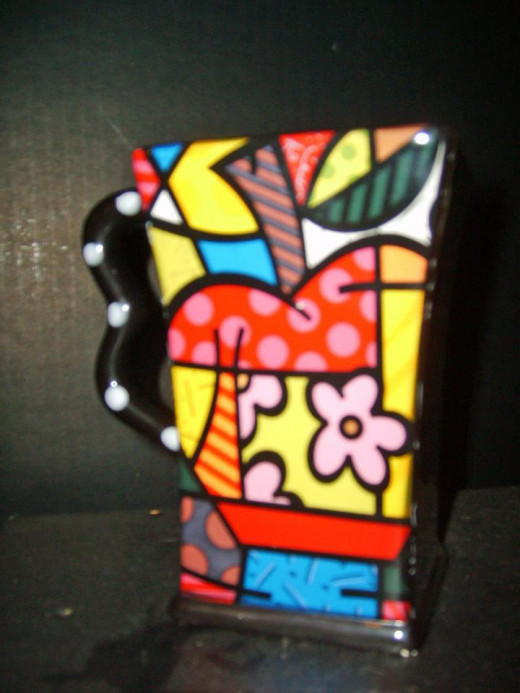 My daughter in-law collects Romero Britto - new and with original box $2.50.