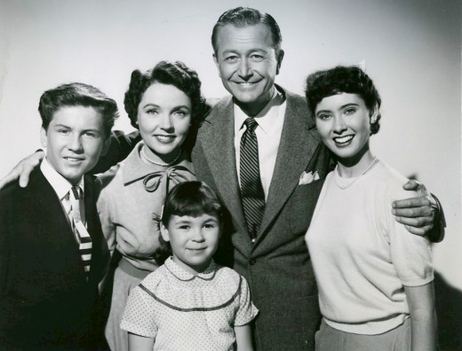 "Lauren Chapin was born May 23 1945 and was the child actress ""Kathy Anderson"" in the television show Father Knows Best. The 1954 cast photo, Back, from left: Billy Gray, Jane Wyatt, Robert Young, Elinor Donahue. At the front is Lauren Chapin."