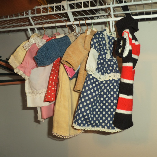 I couldn't hang all her outfits as I ran out of hangers, so some are stored in decorative boxes.