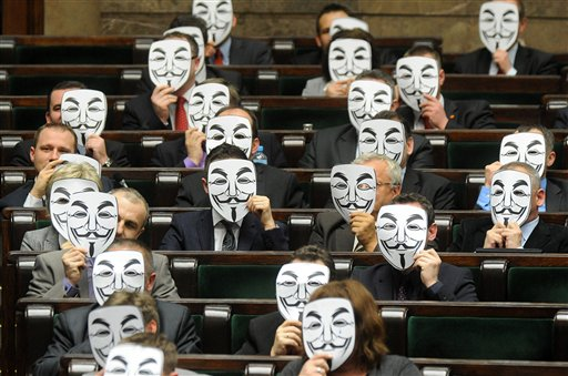 Lawmakers from the leftist Palikot's Movement cover their faces with masks as they protest against ACTA, or the Anti-Counterfeiting Trade Agreement, during a parliament session, in Warsaw, Poland.