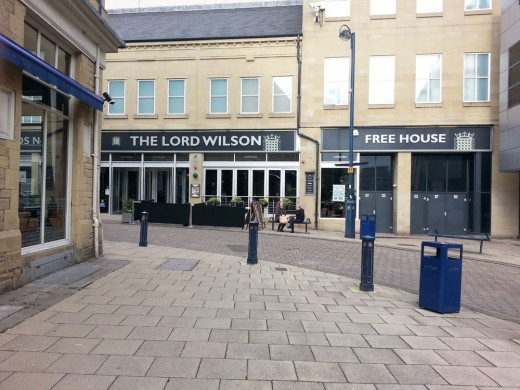 The Lord Wilson, Unit 27, Kingsgate Centre, King Street, Huddersfield, West Yorkshire, HD1 2PZ.