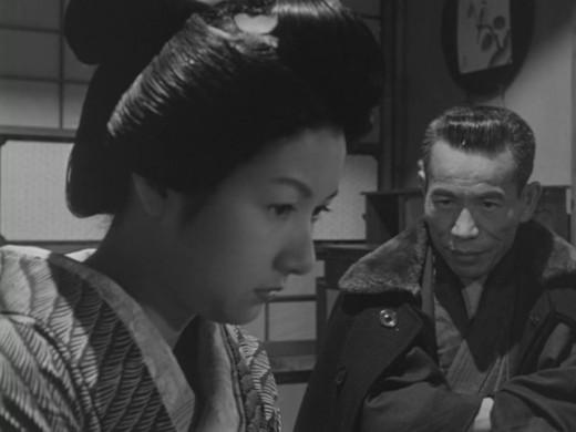 Otama (Hideko Takamine) is confronted by the rich man who keeps her, Suezō (Eijirō Tōno) in Shirō Toyoda's Wild Geese [aka The Mistress] (1953)