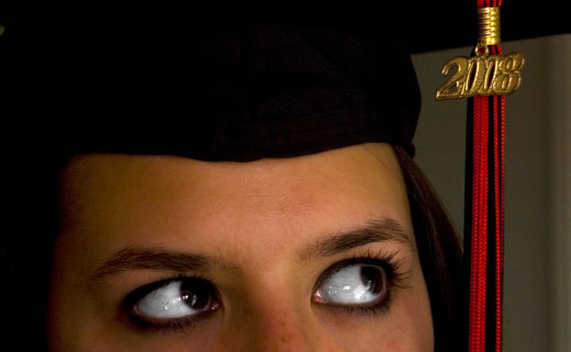 Girl thinking with graduation cap