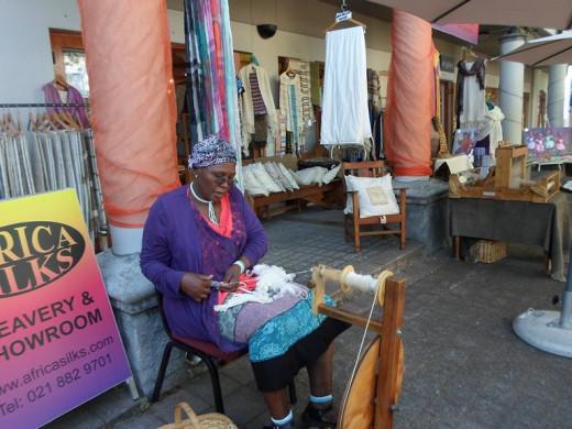 A Xhosa woman weaving exclusive garments in Stellenbosch, Western Cape, South Africa