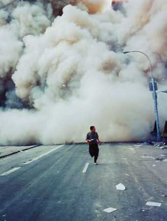 Person running in front of dust-cloud in Manhattan on 9/11/01