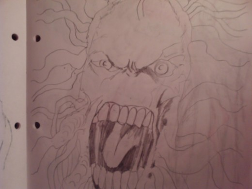 An angry face with tentacles coming out of it's head.