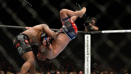 Daniel Cormier slamming Dan Henderson at UFC 173
