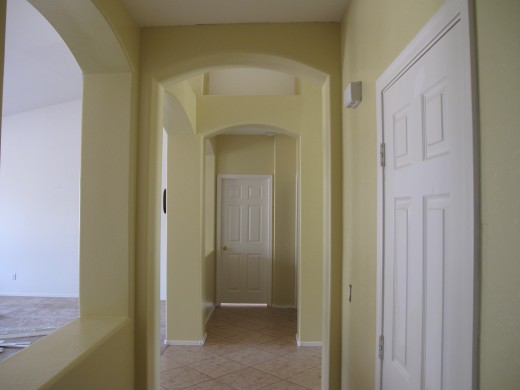 We covered a very dark hallway hiding permanent marker with a lighter-colored paint. It was more than we bargained for!