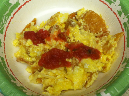 Migas with tortilla chips, onions, sausage, and cheese