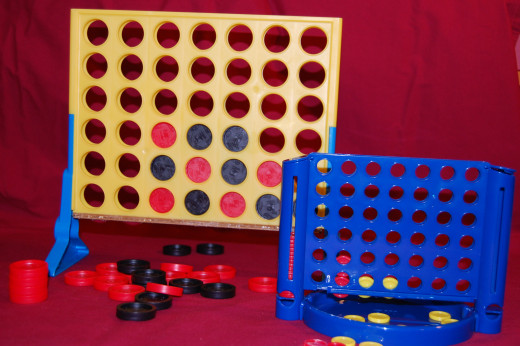 Standard and travel versions of classic Connect Four