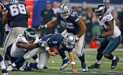 Philadelphia Eagles DE Fletcher Cox (L) sacking Dallas Cowboys QB Tony Romo