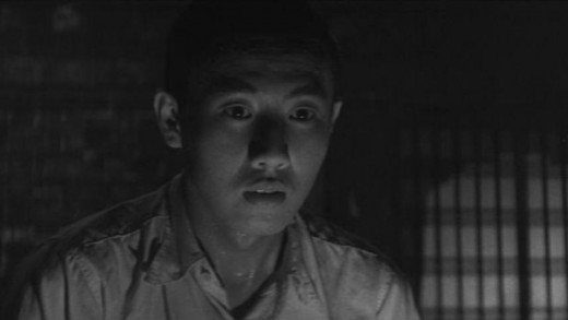 The acolyte (Raizō Ichikawa) contemplates his private hell in Kon Ichikawa's Conflagration (1958)