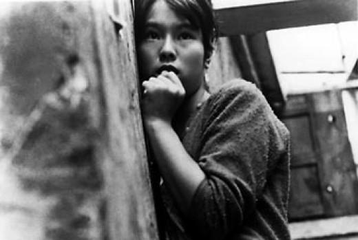 The appropriately worried Haruko (Jitsuko Yoshimura) in Shōhei Imamura's raucous satire, Pigs and Battleships (1961)