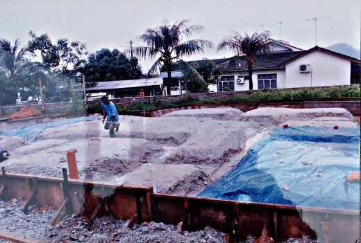 Laying of water-proofing sheets after anti-termite spray