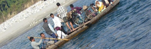 Local rural people crossing the river by boat