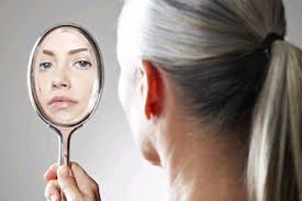 Constantly checking the mirror is one sign of fear for a gray hair