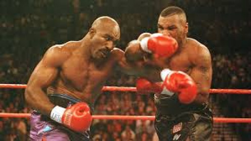 Evander Holyfield, on the left, beat Iron Mike Tyson two times in his illustrious career which including winning the heavyweight crown on four separate occasions.