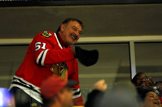 Butkus acknowleedges the Chicago Blackhawks' fans' cheers of appreciation for him